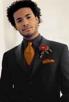 A good example of wearing a flower with a suit.