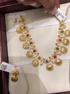 38 net . Beautiful necklace with Ram parivar kasu hangings.  Necklace studded with white pink and green color precious stones. Ear rings also with Ram parivar kasu hangings. Necklace with matching earrings. 29 March 2018