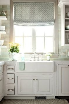 White kitchen with a farmhouse sink and teal backsplash White kitchen with a farmhouse sink and teal backsplash Always wanted to learn to knit, but u. kitchen tools White kitchen with a farmhouse sink and teal backsplash House Of Turquoise, Turquoise Tile, Turquoise Kitchen, Light Turquoise, Alice Lane Home, Sweet Home, Kitchen Window Treatments, Farm Sink, Cuisines Design