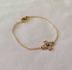 A personal favorite from my Etsy shop https://www.etsy.com/listing/238139477/gold-cross-braceletgold-charm