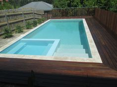 Travertine pool surround with spotted gum decking and batten pool fence