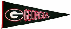 """NCAA Georgia Bulldogs Medium Pennant by Winning Streak. $19.99. This unique wool, vintage style pennant is decorated with distinctive embroidery and applique detail, and highlights the team logo. Ideal as a gift or for decorating an office, gameroom or bedroom.. A uniquely hand-crafted, vintage style, wool pennant featuring intricate embroidery and applique design detail.. Genuine wool blend fabric.. One 32""""L x 18""""H licensed wool pennant featuring the logos of your f..."""
