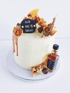 Jack Daniels 18th Birthday Cake. A chocolate jack daniels flavoured sponge With Popcorn, Cinder Toffee, Rolo and Sugar Shards
