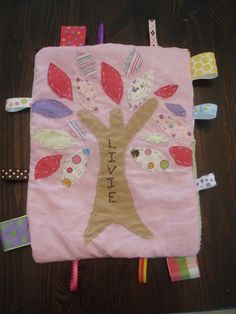 I like the idea of adding the name on the tree for my tag blankets.
