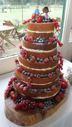 5 Tier Wedding Cake Decorated With Fruits And Icing Sugar Three Flavours Vanilla Sponge Strawberry Jam Ercream Orange