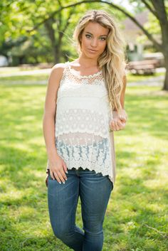 This tank is a summer dream! The front is sheer ivory lace and it is gorgeous! With that being said, you will want a bandeau or cami underneath it! The back is a soft taupe with an adorable tie which creates a trendy keyhole!