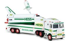 1999 Hess Toy Truck & Space Shuttle with Satellite: Hess boldly went where its toys had never ventured -- outer space. The Toy Truck and Space Shuttle with Satellite came with six batteries to unleash a variety of lights and sounds that roar, beep and flash in various combinations. Press the red button above the shuttle cockpit to make the cargo doors open, and the detachable satellite rises from the bay and its retractable solar panels fall into place.