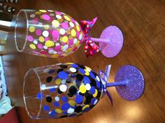 Using gloss acrylic paint, paint dots on clean glasses and allow to dry. Put into a cold oven upside down on a cookie sheet and set temp at 350. Once oven is heated to 350, leave glasses in for 30 mins. Turn oven off and leave glasses in until cooled. Brush modge podge onto stem and base and sprinkle glitter on ( may need a second application ). Cover tops of glass and spray stem and base with clear acrylic waterproof sealer.