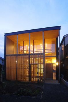 This house was planned in the deepest part of a site divided into three.Because it was expected that next buildings approach in the east and west, I aimed at...