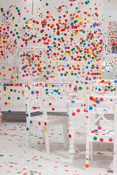 The obliteration room. Children add more and more sticker dots to the all white room.