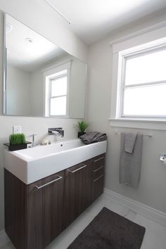 Bathroom Ideas Narrow Bathroom Window With Under Mount Bathroom Sink And Small Toilet Under Frameless Large Mirror Determining The Right Window F
