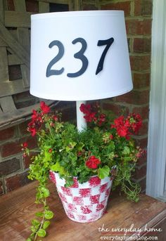 On the solar front porch light. Oh, and a planter. I'm too late to get my front porch decorated for summer. They're solar-powered porch lamp, h Diy Solar, Solar Light Crafts, Solar Lamp, Solar Lights, Garden Crafts, Diy Garden Decor, Garden Ideas, Garden Whimsy, Backyard Ideas