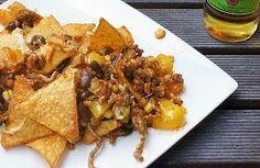 Mexicaans: Ovenschotel met gehakt, paprika, mais, kidneybonen, tomaat, kaas en nacho's