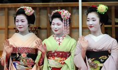 "»Three 'Maikos,' or apprentice geishas, (L-R) Ichitomi, 18, from Gion Kobu, Toshitomo, 16, from Miyagawa cho and Chizu, 20, from Ponto cho wave while attending the ""We're alive and well, Kyoto"" campaign in Tokyo on October 4, 2013. «(MORE)"