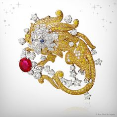 Zodiac Set Leo clip, Palais de la chance collection, Van Cleef & Arpels: yellow gold, yellow diamonds, white gold, diamonds, sapphires and one oval-cut ruby of 3.09 carats.