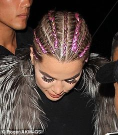 All change: Khloe's purple locks are quite different to the blonde shoulder-length style she was sporting last week (right)