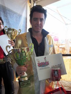 Second place Creme de la King winner Ryan Collingwood showed off his golden voice (and jacket) at the 16th annual Elvis Festival at the OC Market Place! Special thanks to Karaoke Scene Magazine http://karaokescene.com and Magnificent Candles.https://www.facebook.com/pages/Magnificent-Candles/583224535071034