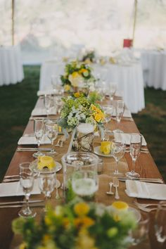 yellow flowers on rustic table