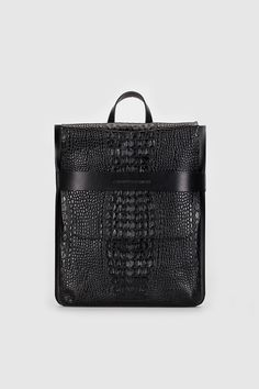 4f0a7445970 Black leather rectangular backpack-bag with detachable straps.