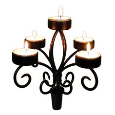Wine Bottle Candelabra at Swoozie's...fits into bottle like a stopper.  Great re-purpose!