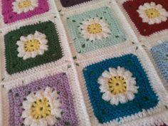 Granny flower square crochet blanket, present for a friend. Bright favourite colours http://humbugshouse.wordpress.com/