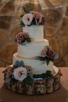 Such a beautiful + simple wedding cake for a blush//rustic wedding! Love the simple, white texture of the three layers, the blush pink + greenery added on, and the tree stump base. Absolutely stunning! Taken at THE SPRINGS Event Venue in Sperry, OK. Book your free tour today! Photographer: Kelbert McFarland Photography