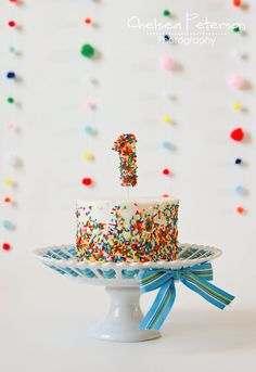 fun rainbow sprinkle cake Smash cakes are small frosted cakes made just for the birthday guest of honor. Give it to your kid and let him or her dig into it with their hands. Baby Boy Cakes, Cakes For Boys, First Birthday Cakes, 1st Boy Birthday, Simple 1st Birthday Party Boy, Colorful Birthday Cake, Baby First Birthday Cake, Rainbow First Birthday, Birthday Ideas