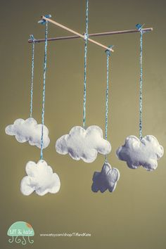 Our very first product for etsy! A hand sewn felt cloud baby mobile. http://www.etsy.com/shop/TiffandKate