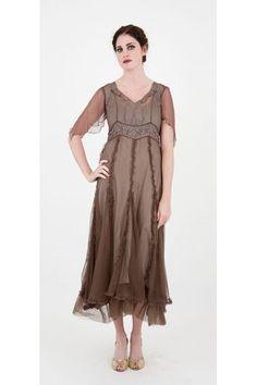 acb4cbb703e2 ... an empire waist, a scoop neckline and sheer sleeves, layered hemline.  See more. http://www.natayadresses.com/1079-thickbox/nataya-