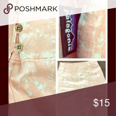 """Patagonia Hemp & Organic Cotton Lightweight Skirt Peachy pink skirt with a delicate floral design from Patagonia. This skirt is extremely lightweight made of 55% hemp, 37% poly, 8% organic cotton. Quality you'd expect from Patagonia. Has one inside button and three outside buttons. 24"""" long. EUC Patagonia Skirts"""