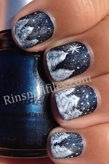Snowfall. China Glaze Little Drummer Boy base, then sponged very lightly with Sinful Snow me White. Next free-handed snow covered trees using white acrylic paint.