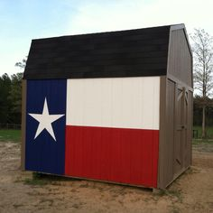 Texas flag painted on the horse shed.