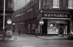 Maynards confectionary shop on the corner of Grey Street and High Bridge, Newcastle-upon-Tyne, England. That looks like the rear of a Triumph Stag outside the premises, so I'll date this picture to or High Bridge, North Shields, Great North, North East England, Shop Fronts, Industrial Revolution, Local History, Historical Pictures, Newcastle