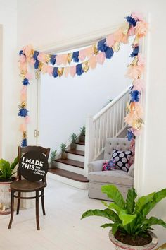 love the colour scheme of this Tissue Paper Garland by LuLu Lucky (so cute!)