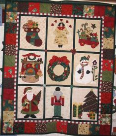 I've made this quilt...it's a Debbie Mumm pattern and was such fun to do. Christmas quilt #1 by Ribbonwiz, via Flickr