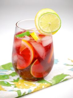 Classic Red Sangria with Citrus  (1 bottle dry red wine 1/4 cup lemon vodka 1/4 cup orange vodka 1/4 cup brandy 1/2 cup freshly squeezed orange juice 2 Tbs simple syrup 8 lemon slices 8 lime slices)