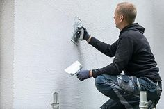 Photo about Construction worker putting white decorative plaster on house exterior. Image of cement, renovation, wall - 101035791 Plaster Walls, Stucco Exterior, Stucco Walls, Eco Construction, Sustainable Building Materials, Cinder Block Walls, Masonry Work, Drywall Installation