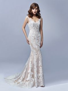 Gorgeous embroidered lace wedding dress by @enzoani