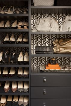 Gray shelves lined with wallpaper, what a chic closet.