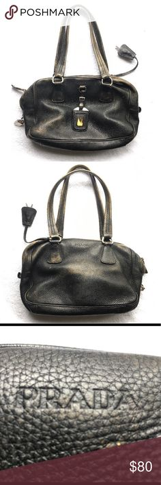 "PRADA ID Leather Satchel Bag Purse PRADA ID Leather Satchel Bag Purse  Comes with lock, ID tag and 2 keys  Camel leather bag that was dyed black. Has a great false ""weathered"" look with spots of the camel showing through  Otherwise the bag is in great condition. Couple of spots inside (see pic). Prada Bags Satchels"