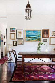 Introduce color into your dining room with a gallery wall and printed Turkish rug