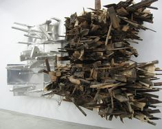 Leonardo Drew's curse-worthy sculpture (It's true! While taking these photographs I heard three different visitors swear in amazement when they entered) is on view at Sikkema Jenkins Gallery in New York. Using thousands of wood scraps, he has assembled multiple towering wall pieces with a monstrous wall that snakes through all four rooms of the gallery. A few select pieces are below in order of display.