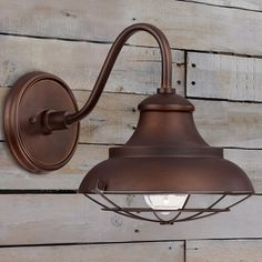 Restoration Barn Outdoor Sconce - Medium Add restoration style to your urban farmhouse, city loft or country retreat with these burnished bronze outdoor wall sconces. 1-100watt medium base bulb. Wet rated.