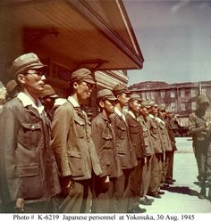 Japanese personnel stand in formation, during the surrender of the Yokosuka Naval base to U.S. Navy and Marine Corps forces, 30 August 1945. Photographed by Lieutenant Dewey Wrigley. Official U.S. Navy Photograph, now in the collections of the U.S. National Archives.