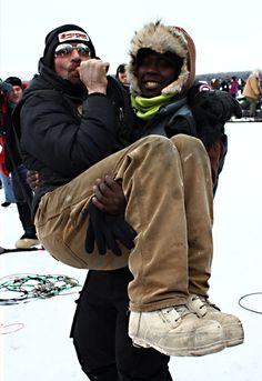 Newton Marshall (Jamacian Musher) and Lance Mackey joking around before the start of the 2013 Iditarod