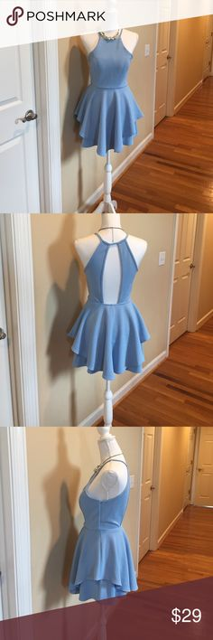 Beautiful Blue dress with cut out back Light blue dress with layered hem and cut out back. Just in time for spring weather. Soft polyester that has stretch. Very flattering. Sewn in cup pads for support. Size M Papaya Dresses Mini