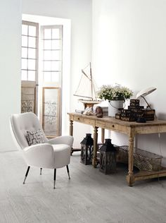 this chair.  whites with rustic wood and metal look chic and cozy.