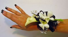 prom wrist corsage pictures | Black & white Calla wrist corsage with orchid blooms