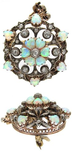 Edwardian Diamond & Opal Hearts Pendant / Brooch. It was made in the 1900s which is considered to be a golden age for English jewelry. Set in 15k gold, silver, with diamonds and heart shaped opals in a central flower cluster.: