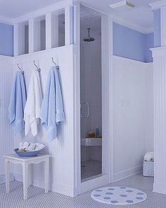 Shower with Partial Walls I love a big walk in shower and this shower gives you privacy without making you feel all closed in.